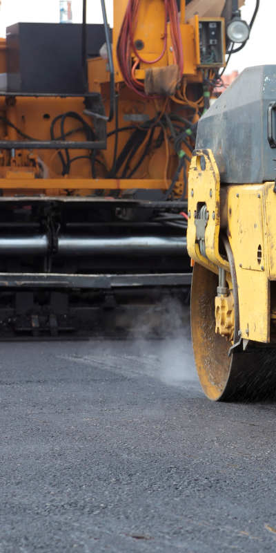 Asphalt roller working on parking lot